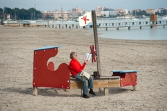 Women on beach reading book, Santiago de la Ribera.